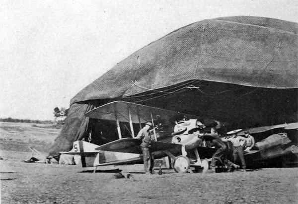 Tuning up a Spad in a Field Hangar at the Front U. S. Air Service Photo